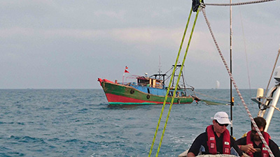 Dare To Lead with nearby Chinese fishing vessel