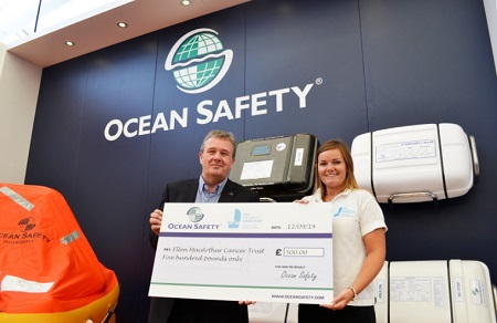 Ocean Safety present a cheque to the Ellen MacArthur Cancer Trust